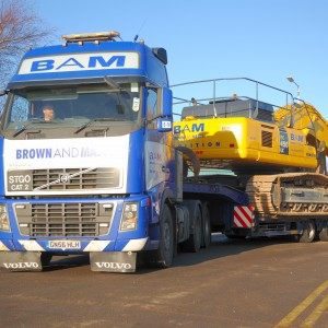 Low Loader leaving yard with PC450